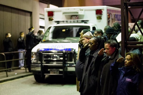 POLICE PAYING RESPECT TO THEIR FALLEN BROOKLYN COMRADES