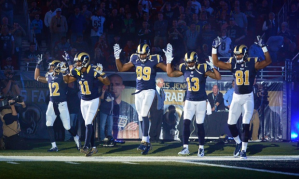 St. Louis Rams raising hands in solidarity with Michael Brown
