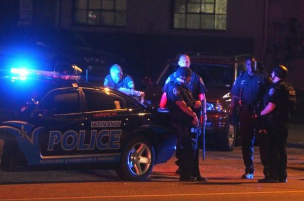 Ferguson police managing protests