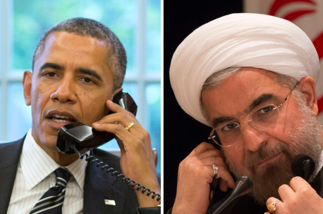 U.S. President Barack Obama talks with Iranian President Hassan Rouhani during a phone call in the Oval Office at the White House in Washington September 27, 2013. REUTERS/Pete Souza