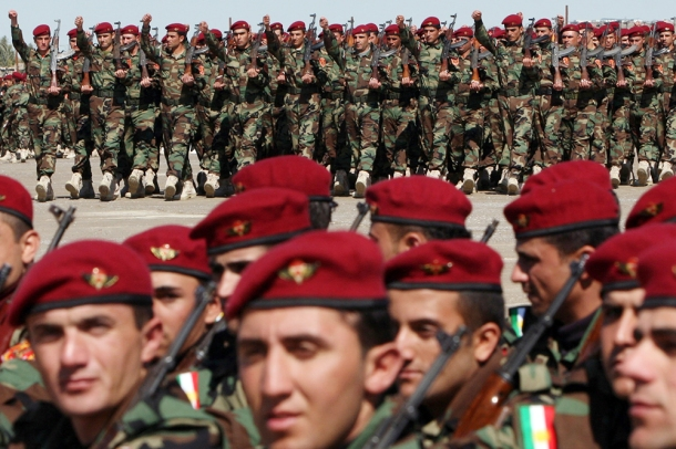 Kurdish Peshmerga soldiers parade during their graduation ceremony in the northern Kurdish city of Erbil on March 2, 2010. (Photo credit should read SAFIN HAMED/AFP/Getty Images)