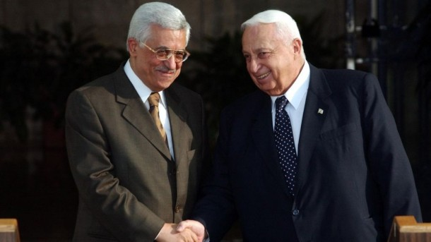 Israeli Prime Minister Ariel Sharon (right) with Palestinian leader, Mahmoud Abbas