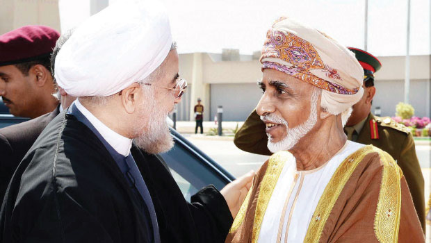 Iranian President Hassan Rouhani (left) and Sultan Qaboos of Oman