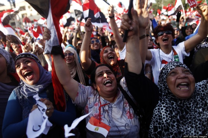 Egyptian women shout slogans against President Mohamed Morsi as they join hundreds of thousands demonstrating against the Islamist President and the Muslim brotherhood. (Photo credit should read MAHMOUD KHALED/AFP/Getty Images)