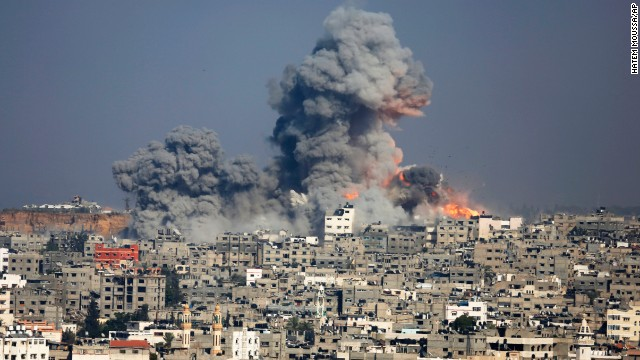 Smoke and fire from the explosion of an Israeli strike rise over Gaza City, Tuesday, July 29, 2014. Israel escalated its military campaign against Hamas. (AP Photo/Hatem Moussa)