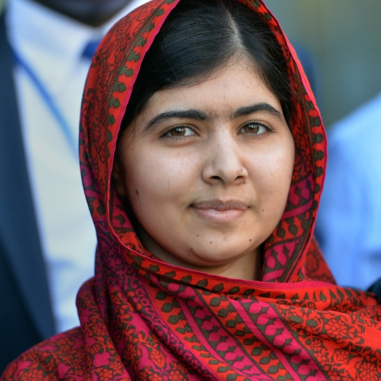 "Pakistani activist Malala Yousafzai meets with students August 18, 2014 at United Nations headquarters in New York. Yousafzai was attending a UN conference called ""500 Days of Action for the Millennium Development Goals"". AFP PHOTO/Stan HONDA (Photo credit should read STAN HONDA/AFP/Getty Images)"