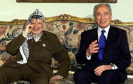 Former Egyptian President Shimon Peres and former Palestinian Chairman Yasser Arafat