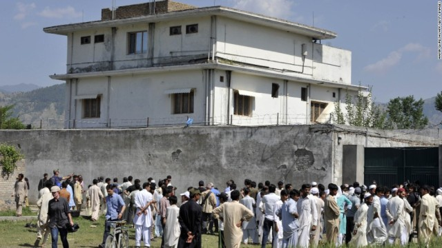 Pakistani media personnel and local residents gather outside the hideout of Al-Qaeda leader Osama bin Laden following his death in Abbottabad. AFP PHOTO/ AAMIR QURESHI (Photo credit should read AAMIR QURESHI/AFP/Getty Images)