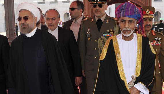Oman's Sultan Qaboos bin Said (R) walks with Iran's President Hassan Rouhani upon Rouhani's arrival in Muscat March 12, 2014. REUTERS/Sultan Al Hasani (OMAN - Tags: POLITICS ROYALS) - RTR3GQAH