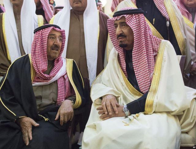SAUDI King Salman, right, talks with Kuwait's emir, Sheikh Sabah Al-Ahmad Al-Jaber Al-Sabah,