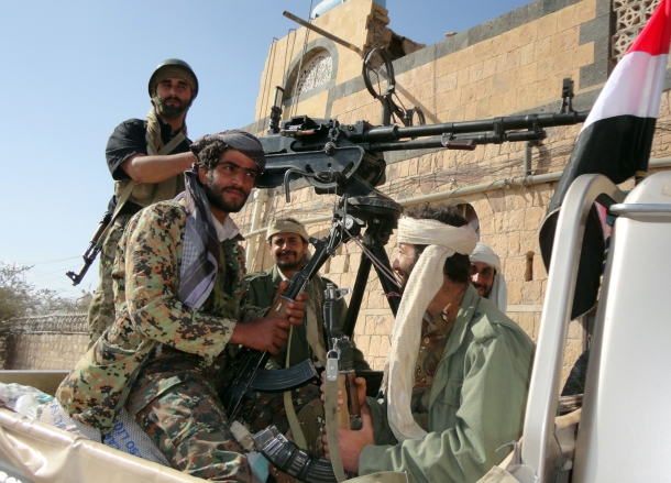 Supporters of al-Qaeda tote their rifles in the back of a pick-up truck in the town of Rada, ) southeast of the capital Sanaa, on January 23, 2012. -/AFP/Getty Images)