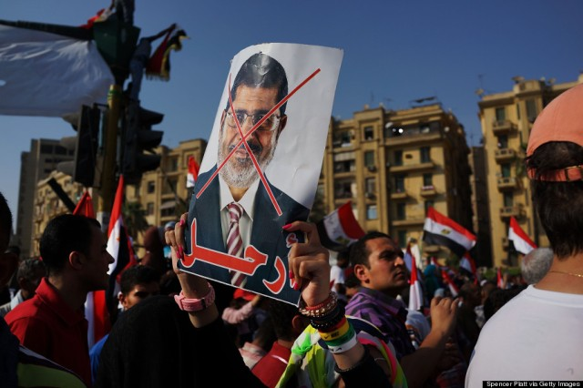 CAIRO, EGYPT - JULY 03: An anti-President Mohammed Morsi poster is viewed. As unrest spreads throughout the country, at least 23 people were killed.(Photo by Spencer Platt/Getty Images)