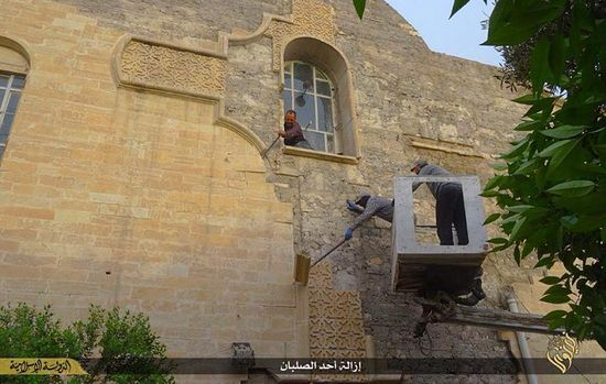Mosul, Iraq-destroying cross by ISIS