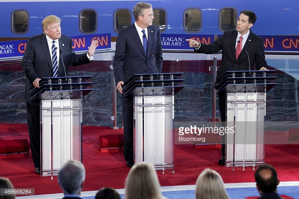 TRUMP AND OTHER CANDIDATES PODIUM 488668284