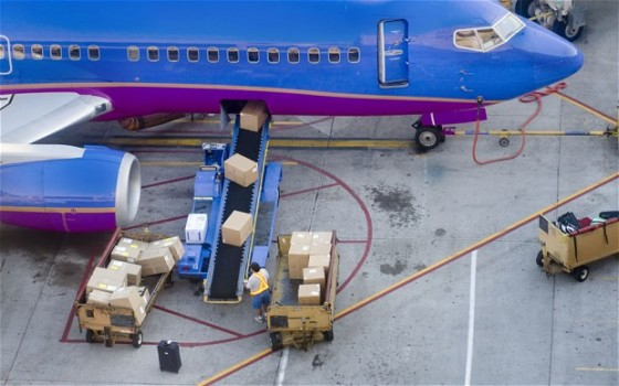 AIRLINES CARGO baggage-is-loaded-by-conveyor-into-airplane-cargo-area-e1384266148626