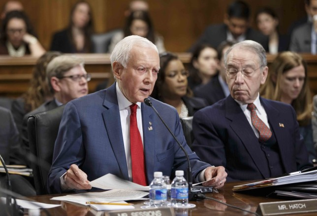 Sen. Orrin Hatch, R-Utah, left, accompanied by Senate Judiciary Committee Chairman Sen. Chuck Grassley, R-Iowa, cite-CIR-investigation (AP Photo/J. Scott Applewhite)