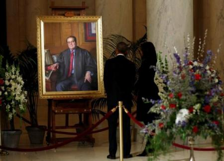 U.S. President Barack Obama and Michelle Obama view portrait of late Supreme Court Justice Scalia at the Supreme Court in Washington