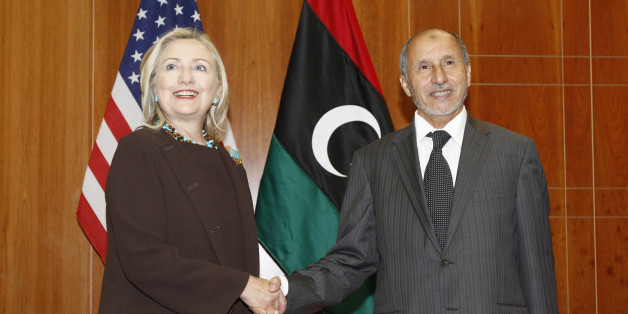 U.S. Secretary of State Hillary Rodham Clinton meets with Libya Transitional National Council President Mustafa Abdel-Jalil at the World Islamic Call Society Headquarters during a visit to Tripoli in Libya Tuesday Oct. 18, 2011. (AP Photo/Kevin Lamarque, Pool)