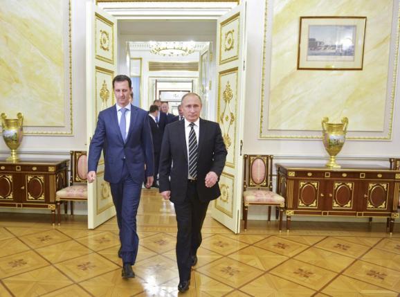 Russian President Vladimir Putin (R) and Syrian President Bashar al-Assad October 20, 2015. REUTERS/Alexei Druzhinin/RIA Novosti/Kremlin