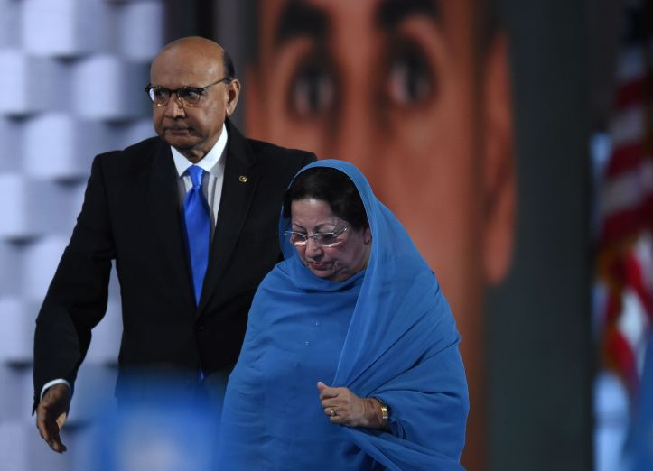 Khizr Khan, father of Humayun S. M. Khan who was killed while serving in Iraq with the US Army, leaves the stage with his wife looks on during the fourth and final day of the Democratic National Convention , (Photo credit TIMOTHY A. CLARY/AFP/Getty Images)
