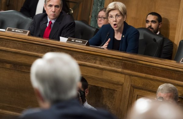 Sen. Elizabeth Warren questions John Stumpf, chairman and CEO of Wells Fargo, about the unauthorized opening of customer accounts by Wells Fargo during a Senate Banking Committee hearing Tuesday. Saul Loeb/AFP/Getty Images