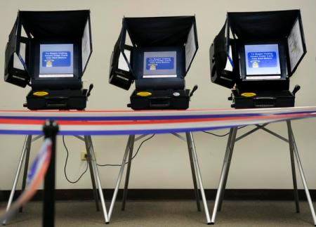 Early Arapahoe County voters use touch-screen voting machines at the Arapahoe County Voting Center in Littleton on Tuesday, Oct. 30, 2012. Kathryn Scott Osler, The Denver Post
