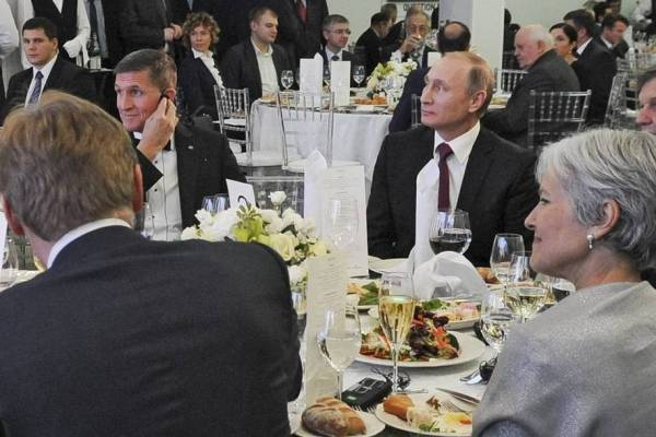 Both Jill Stein and Mike Flynn are sitting at table with Russian President Putin